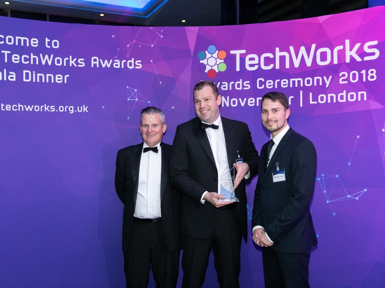 McLaren Applied Technologies' Steve Lambert (centre) & Pascal Arnold (right) received the awards