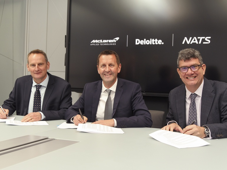 Mark Mathieson, McLaren, Mark Cooper, Deloitte and Martin Rolfe, NATS, sign the agreement