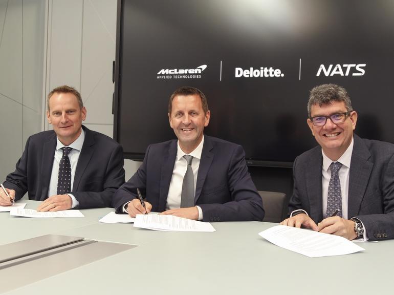 Mark Mathieson, McLaren, Mark Cooper, Deloitte and Martin Rolfe, NATS, sign the agreement