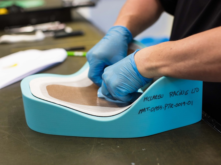 The shield is manufactured from three types of fibres held together by a toughened resin system